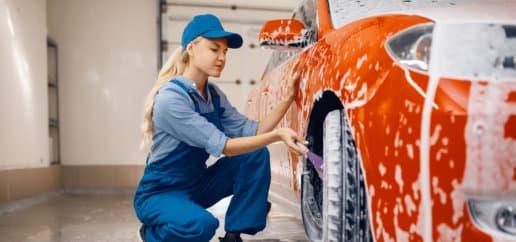 a lady washing the vehicle
