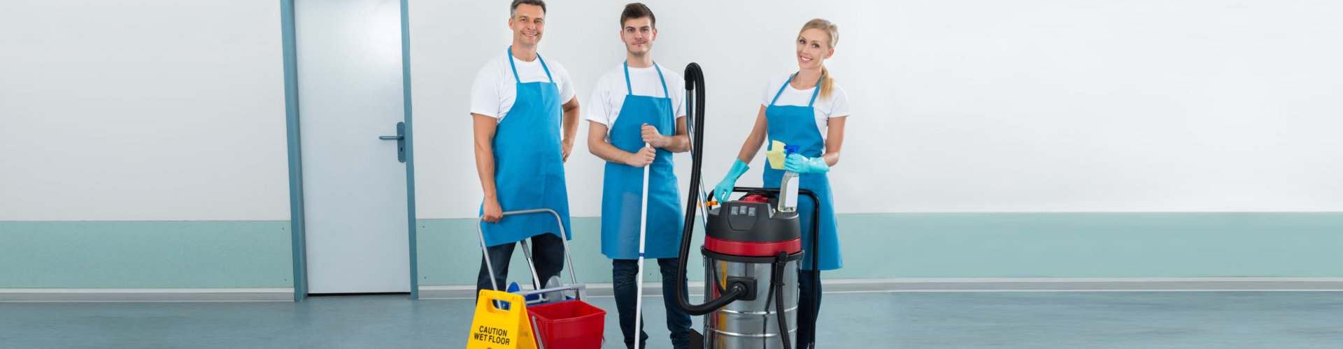 team of cleaners smiling